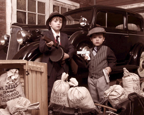 Two Young Boys Dressed Like Gangsters in Old Times