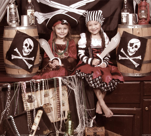 Two Girls Dressed in Pirate Costumes