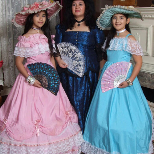 Three Women Wearing Victorian Dresses