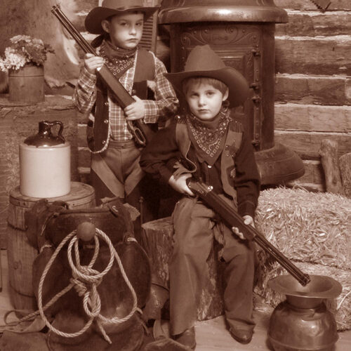 Two Young Boys in a Vintage Cabin Themed Portrait