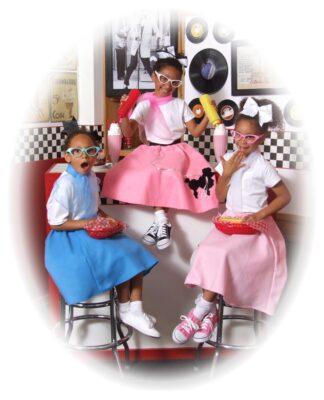 Portrait of Three Smiling Girls