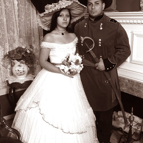 Couple Wearing Civil/Victorian Outfit