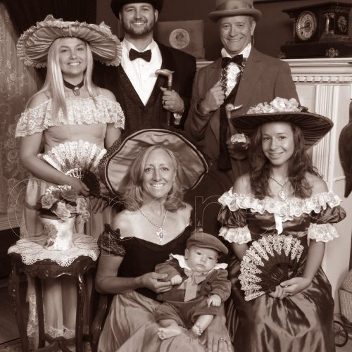 Men and Women in Victorian Themed Outfit