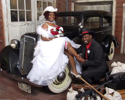 Newly Wed Couple on a Vintage Car