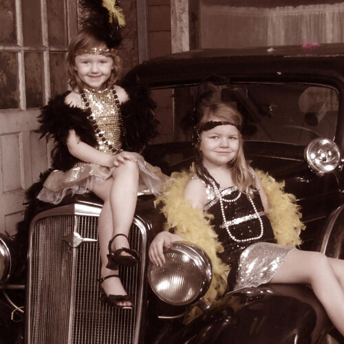 Two Young Girls Dressed in Vintage Style Costumes