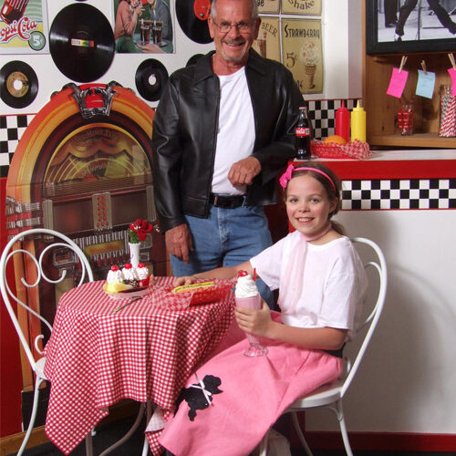 A Father And His Daughter At The 50s Diner