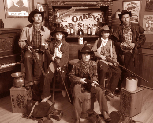 Young Men Dressed as Cowboys in a Saloon