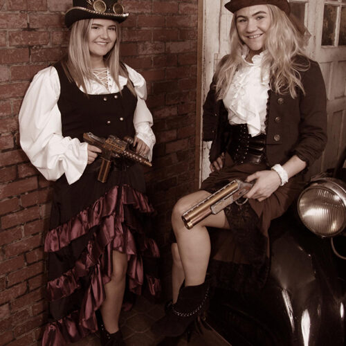 Two Women in Steampunk Costumes