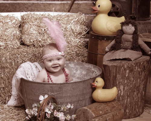 Portrait of a Cute Baby in a Vintage Bath