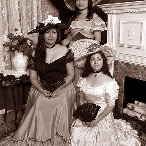 Three Ladies in Victorian Dresses