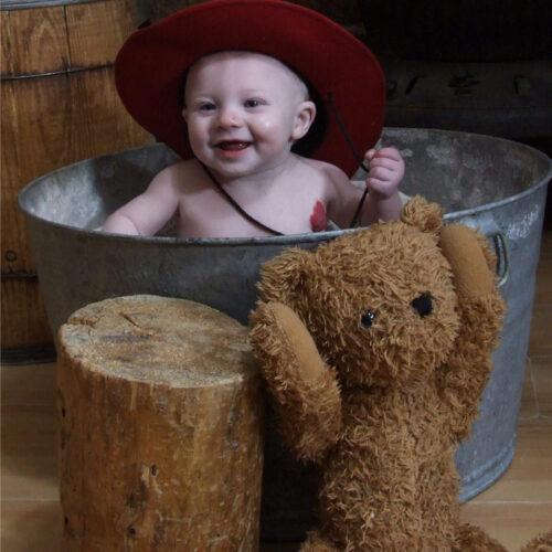 Toddler Enjoying Playing in the Tub