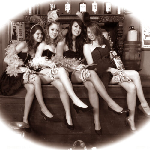 Four Young Women in a Vintage Style Saloon Portrait