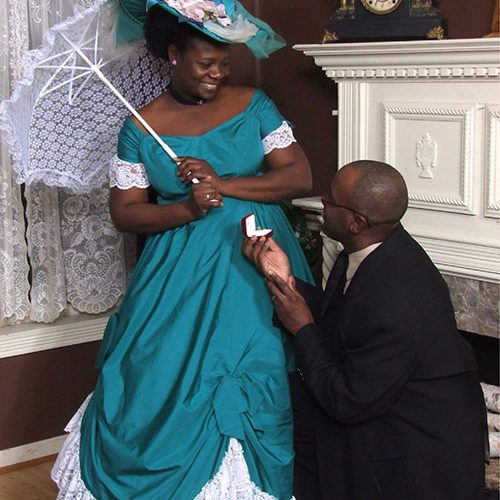 Man Proposing to Woman on a Vintage Outfit